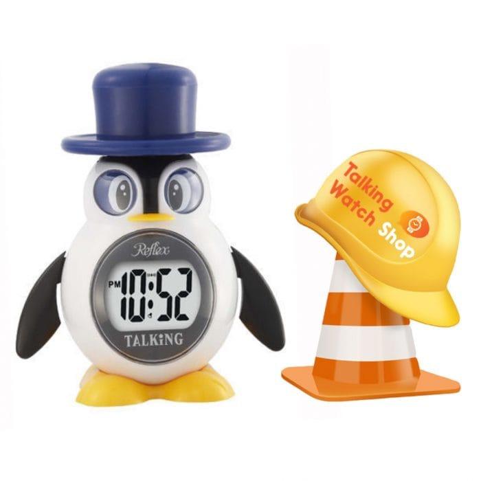 Penguin Clock stood beside safety helmet